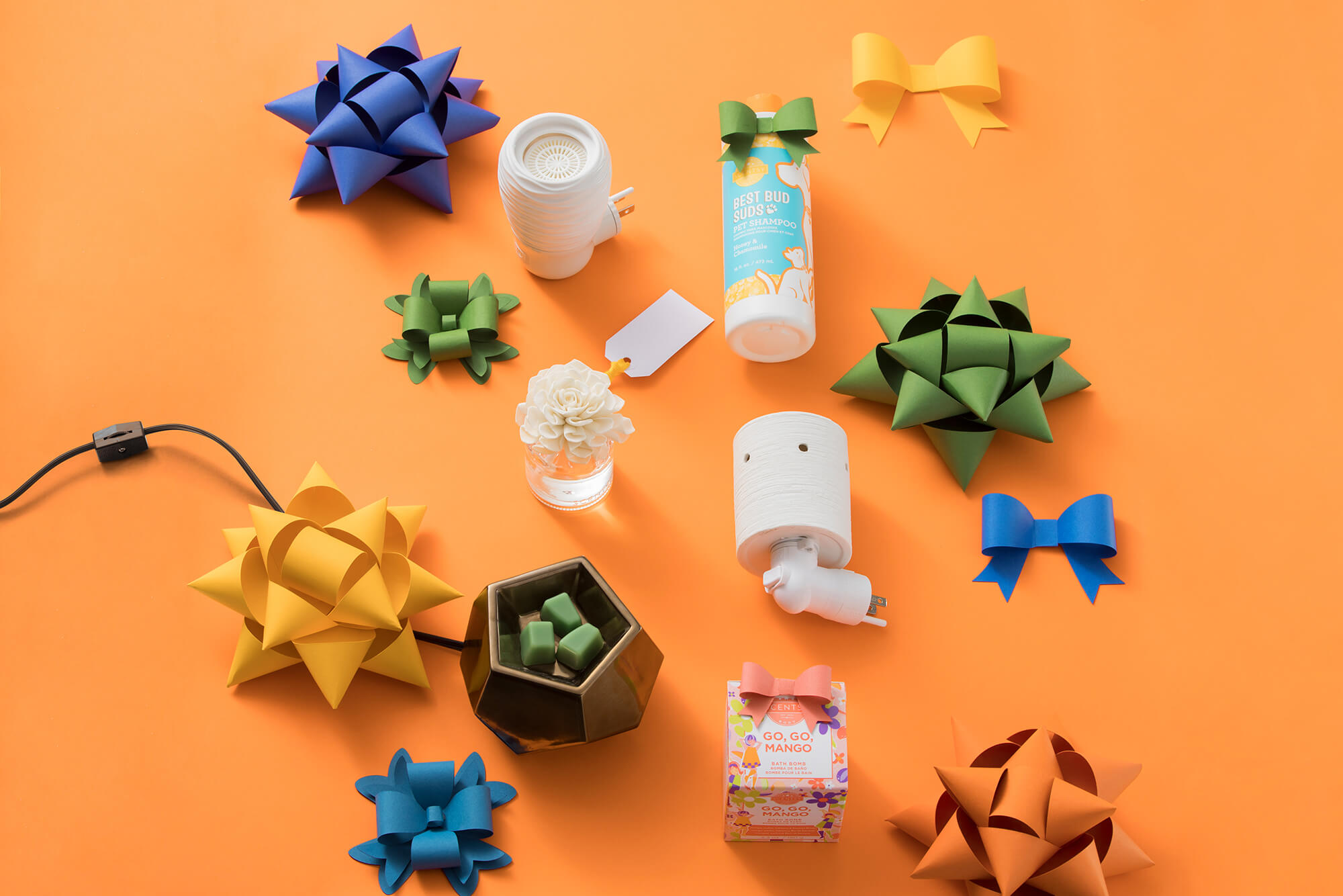 Under $25 Scentsy products featuring - Spin Wall Fan Diffuser, Honey & Chamomile Best Bud Suds Pet Shampoo, Luna Fragrance Flower, Etched Core Mini Warmer, Midnight Copper Warmer, and Go, Go, Mango Bath Bomb