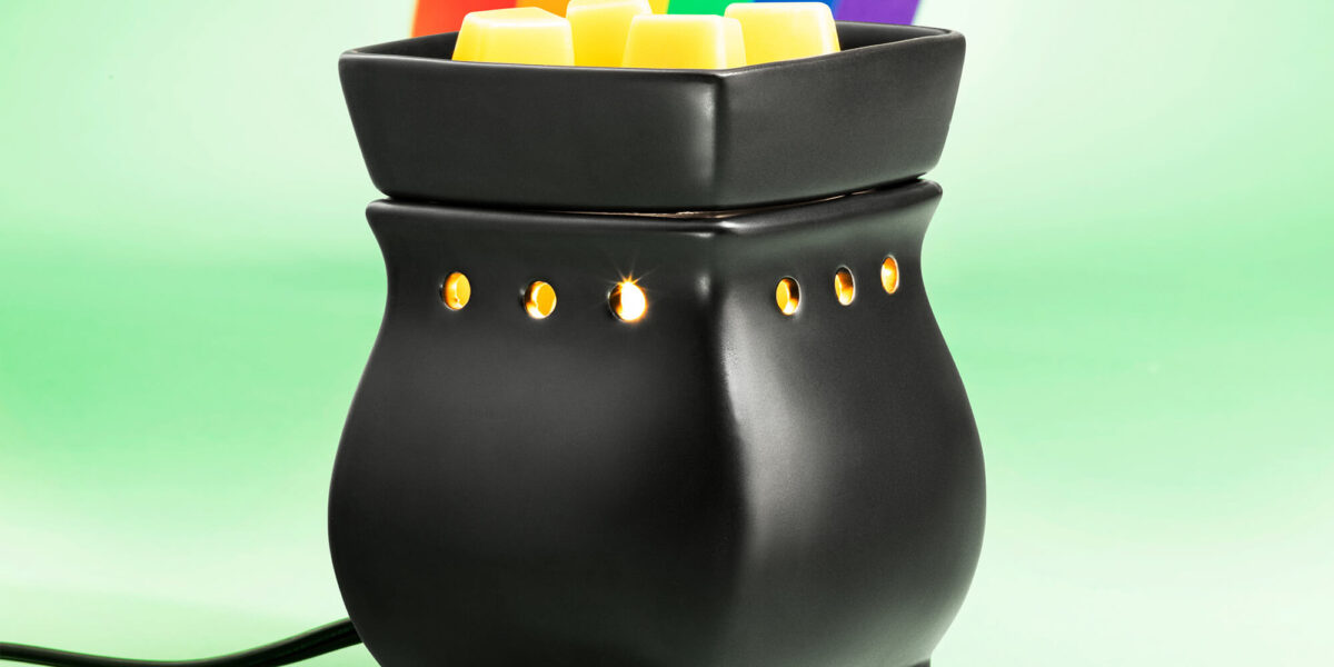 Scentsy's Classical Curve Black Satin warmer with a rainbow coming from it like a pot of gold