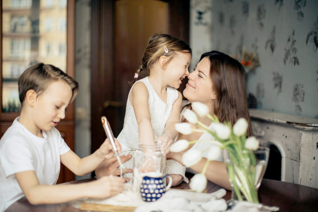 Mother and children sitting at dining room table