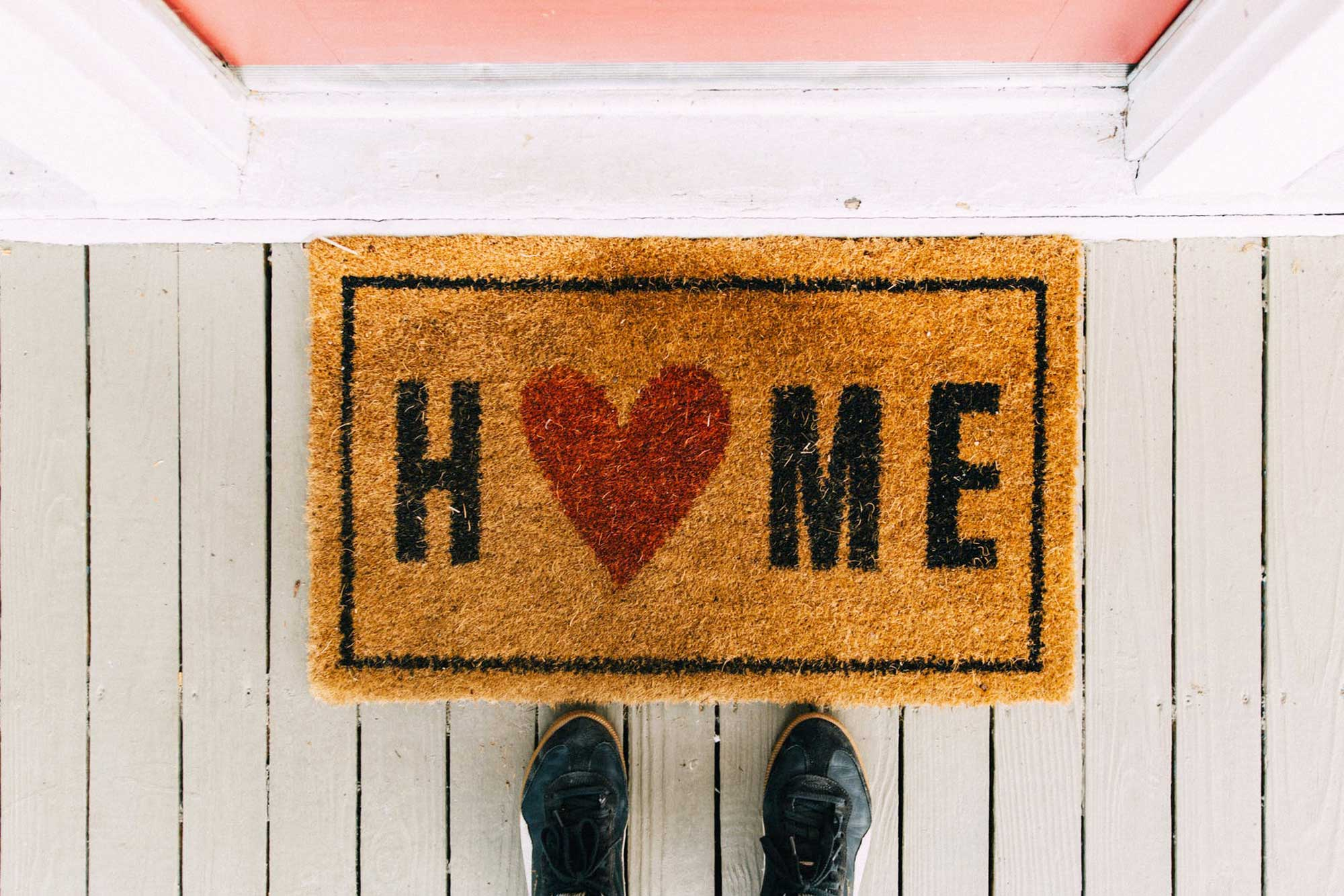 "Doormat that says ""Home"""