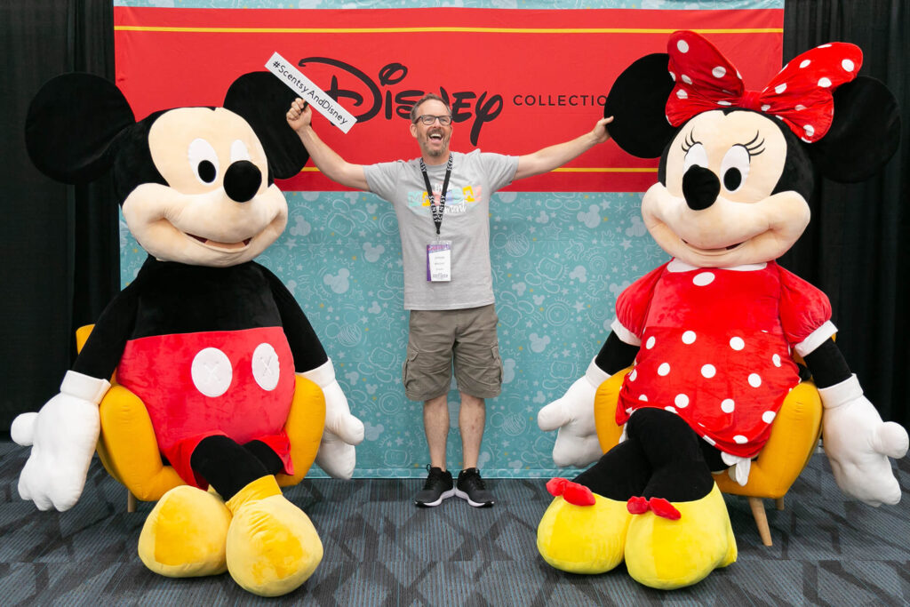 Jason posing with Mickey and Minnie Giant Scentsy Buddies