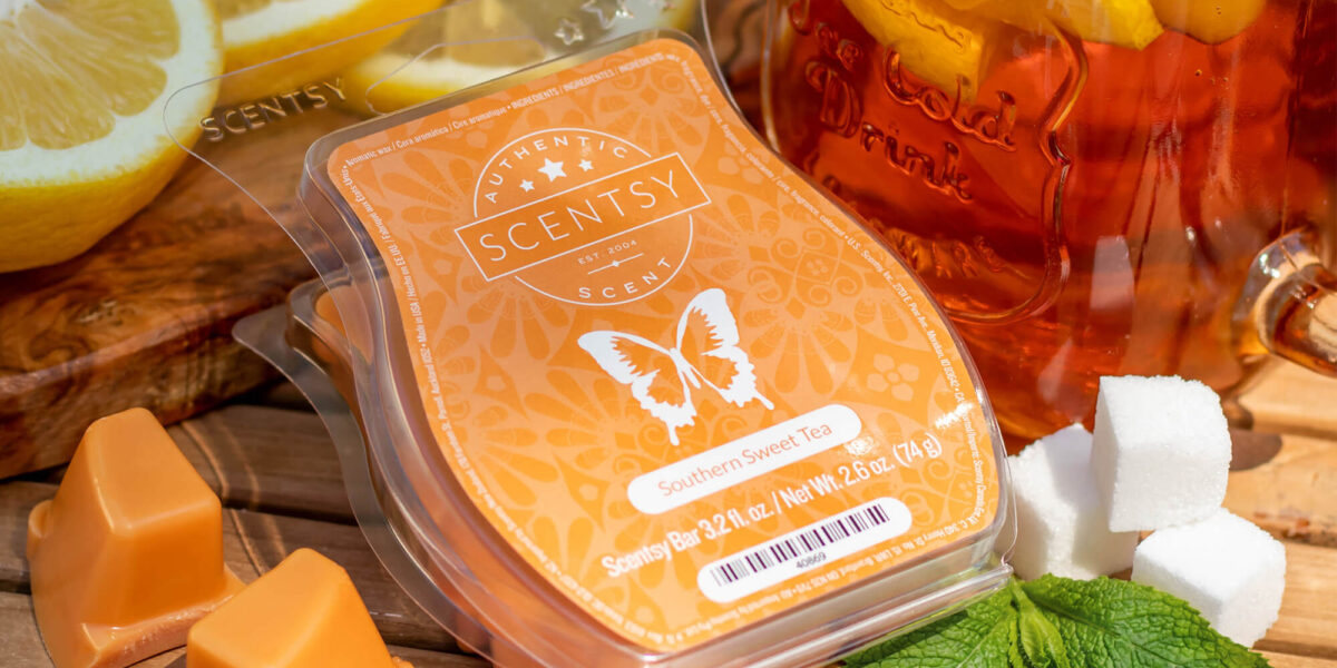 Scentsy Southern Sweet Tea wax bar surrounded by lemon, sweet tea, sugar cubes, and mint