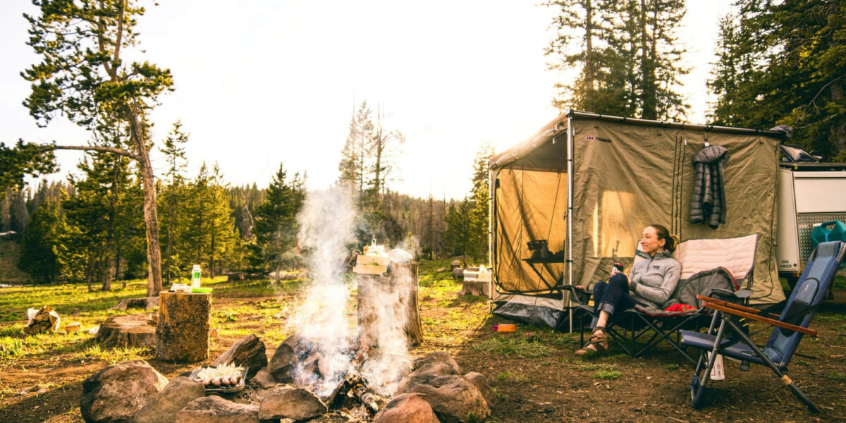 Campsite with smoke coming from firepit