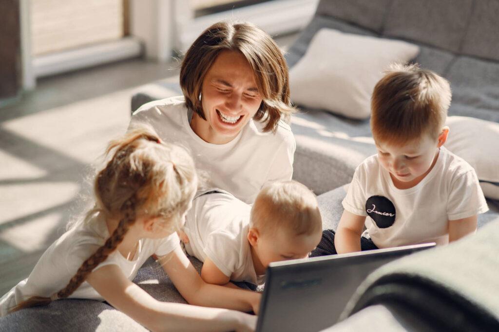 mom and kids playing on computer