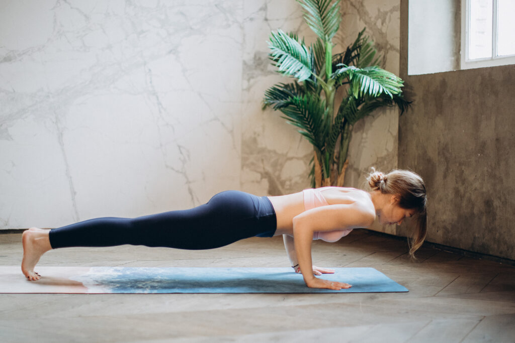 Woman doing a push up on a yoga mat