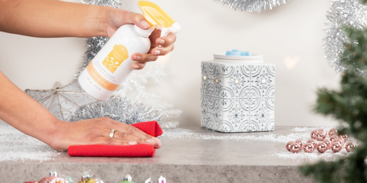 Person cleaning off counter with Scentsy Counter Cleaner