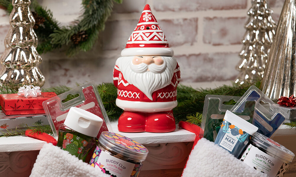 Scentsy products in stockings along with the Be Jolly warmer