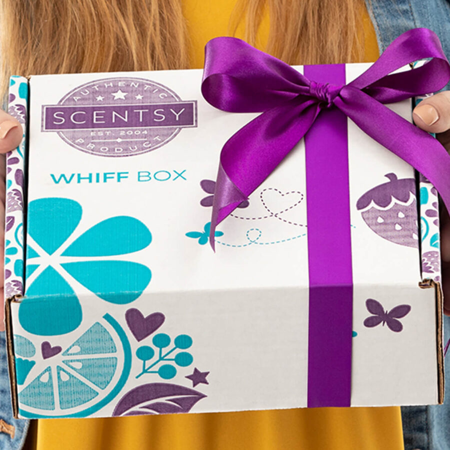 Person holding a wrapped Scentsy Whiff Box