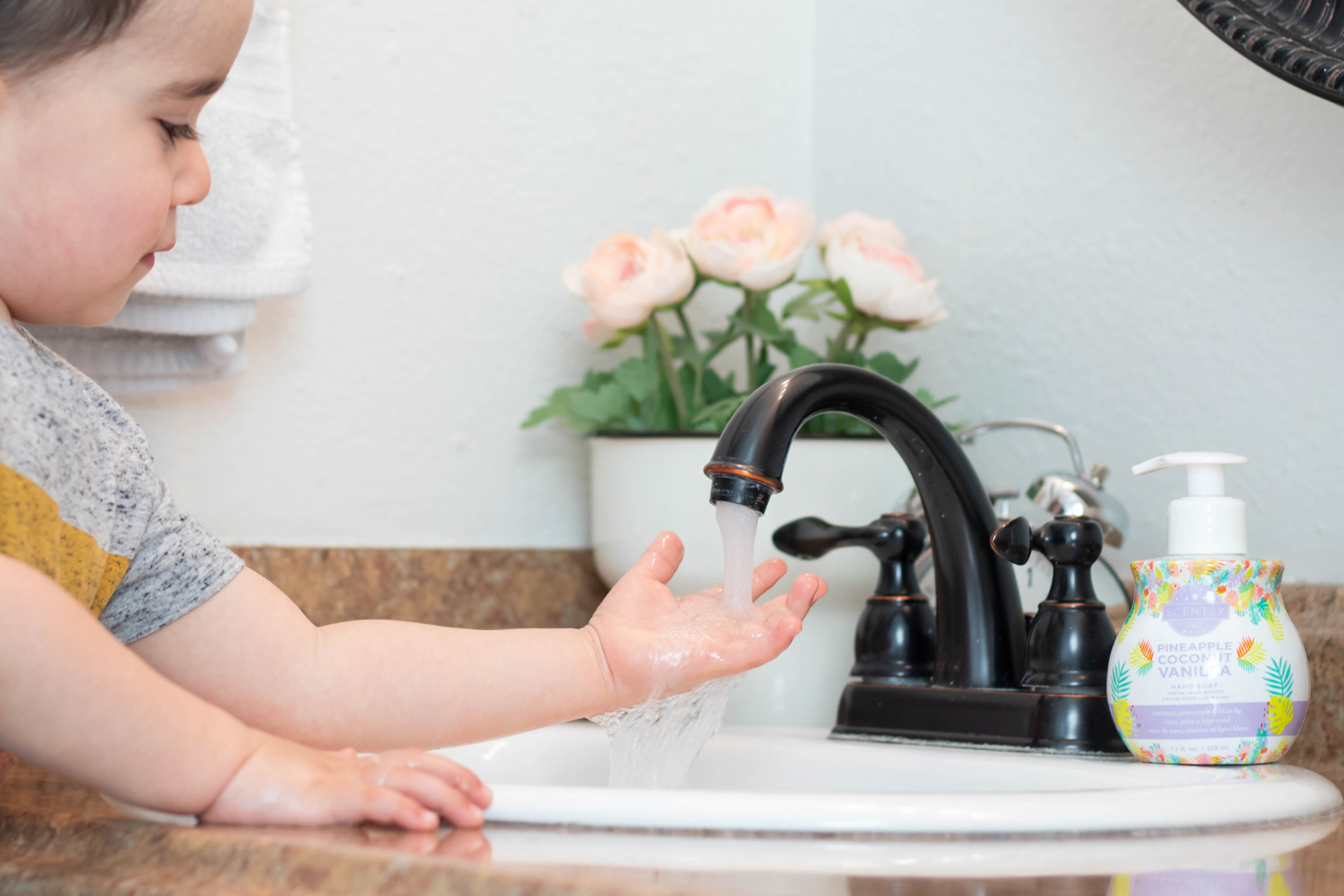 Child washing his hands with Scentsy soap