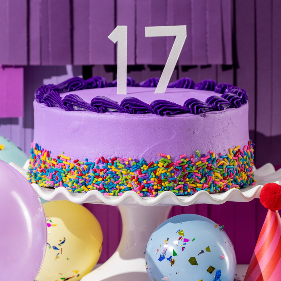 Scentsy's 17th birthday cake with balloons around