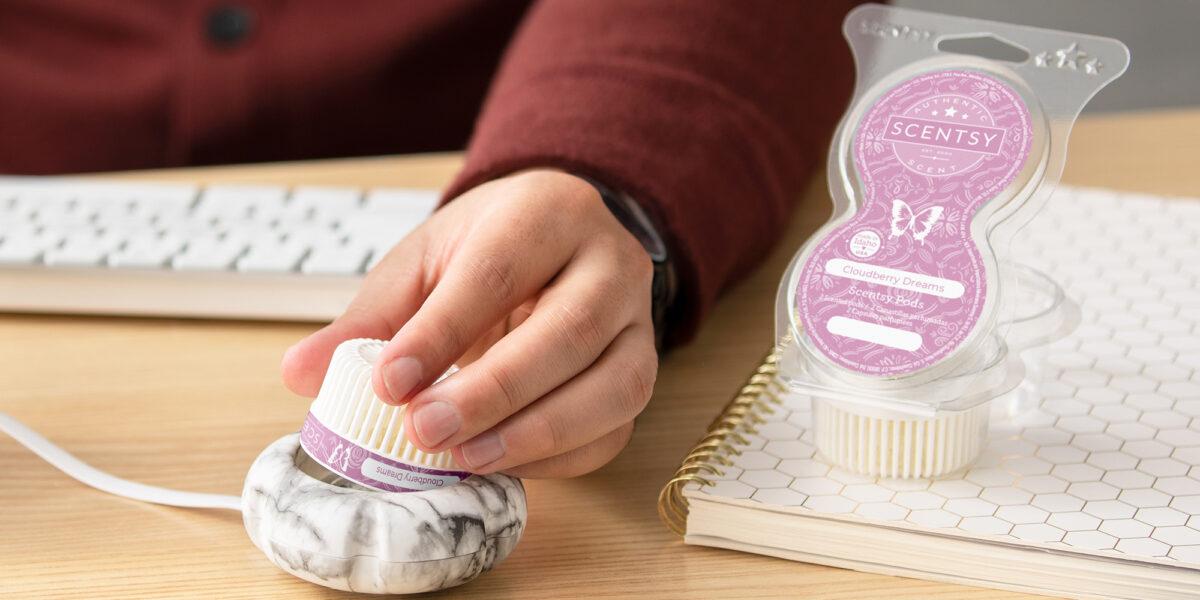 Person placing Cloudberry Dreams Scentsy Pod into a Marble Mini Diffuser