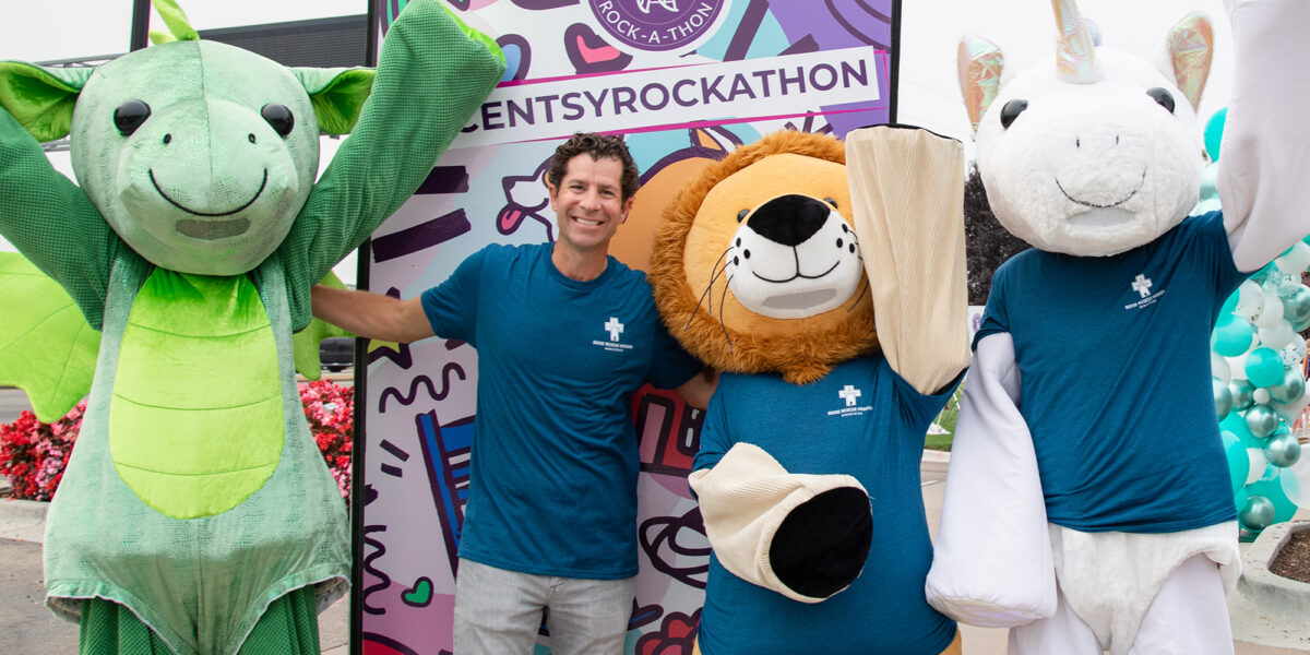 Scentsy Rock-a-Thon Daniel Orchard posing with Scentsy Buddies