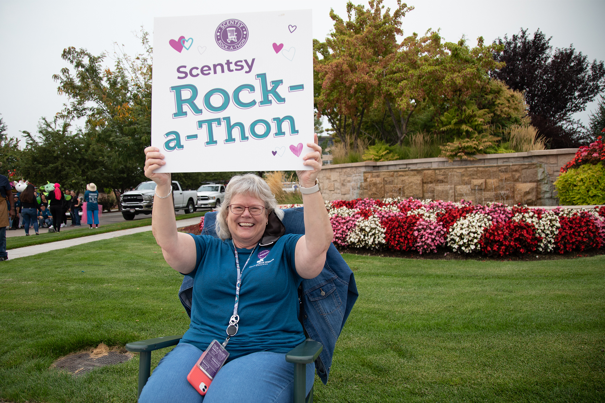 Scentsy Rock-a-Thon: Person rocking holding a sign
