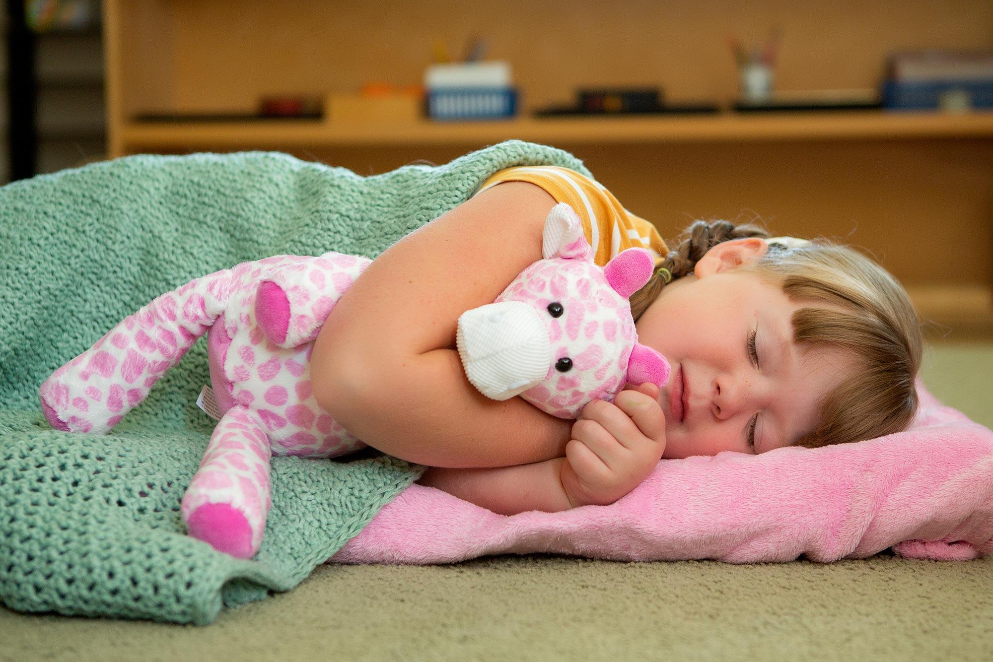little girl sleeping with pink giraffe Scentsy Buddy