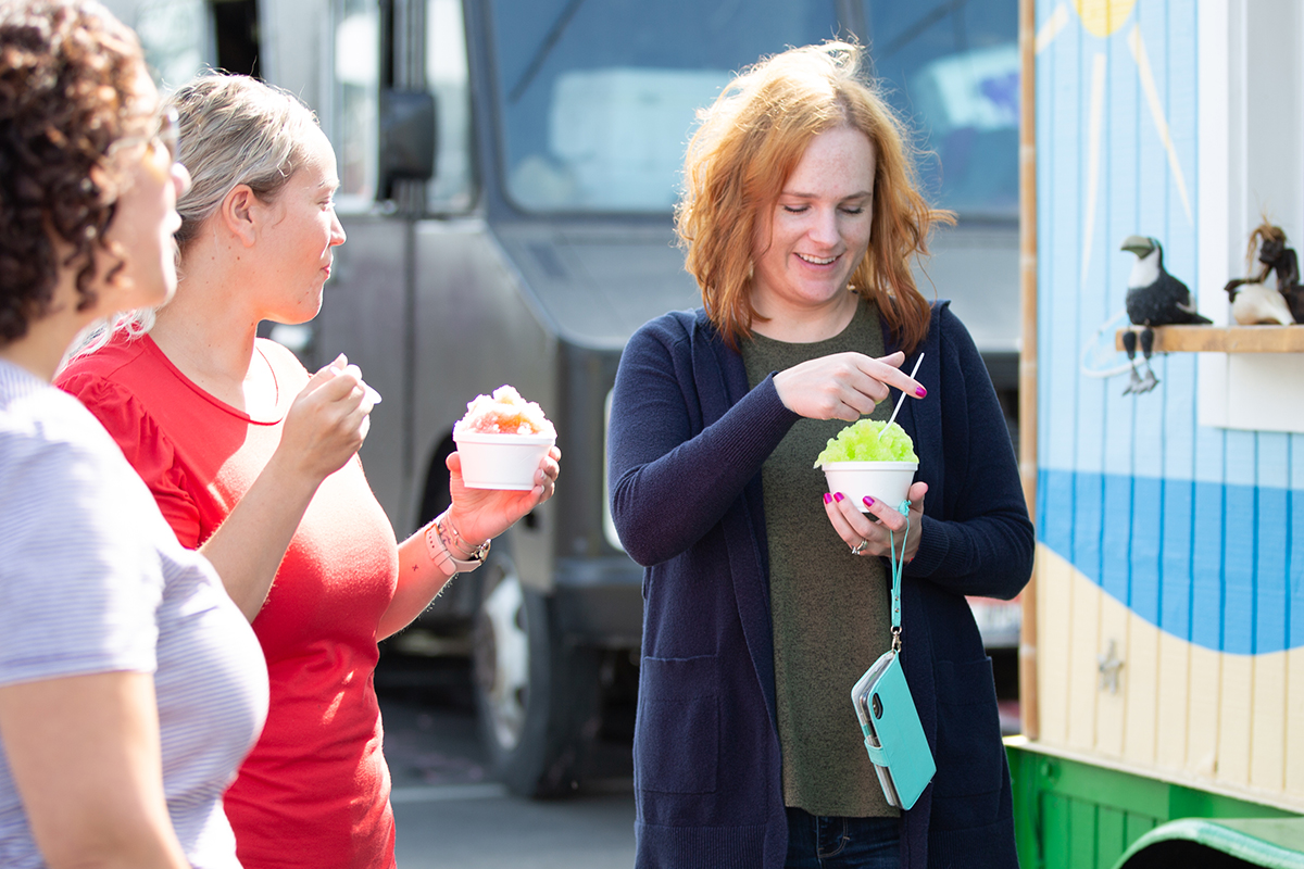 People enjoying snow cones from food truck