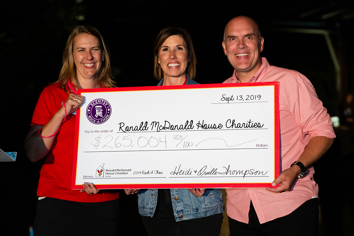 Orville and Heidi Thompson with big check to Ronald McDonald House