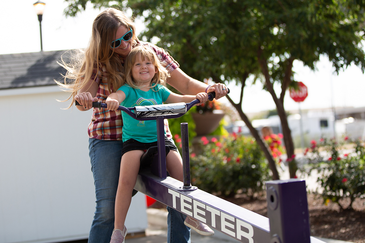 mom and daughter on teeter totter