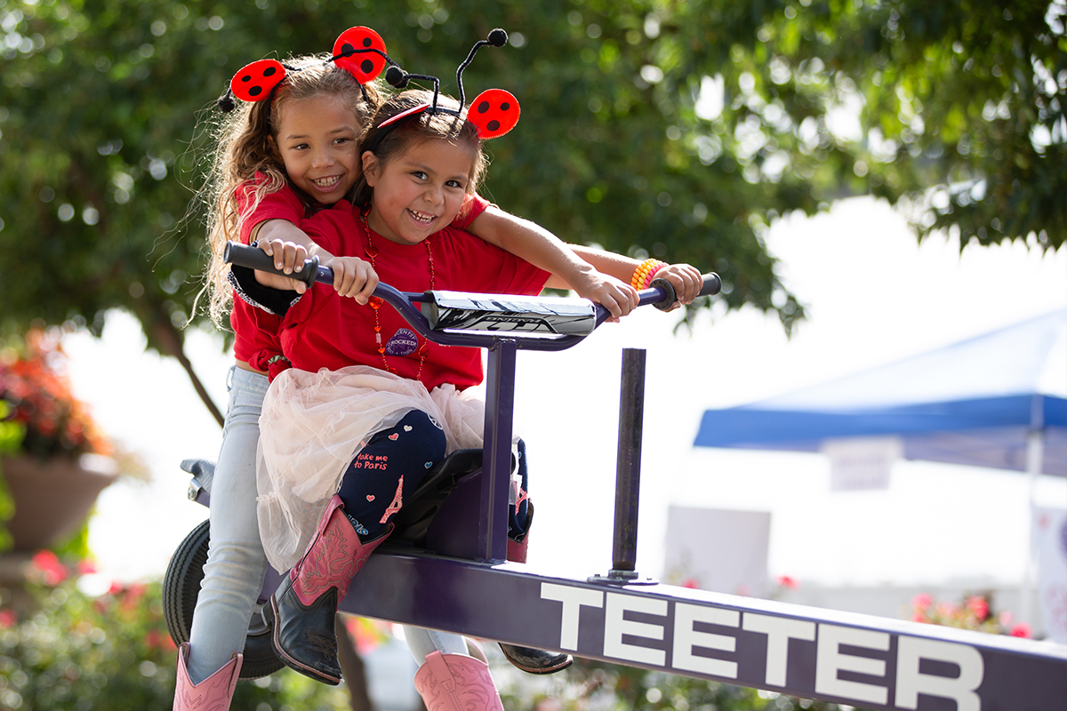 two sisters on teeter totter