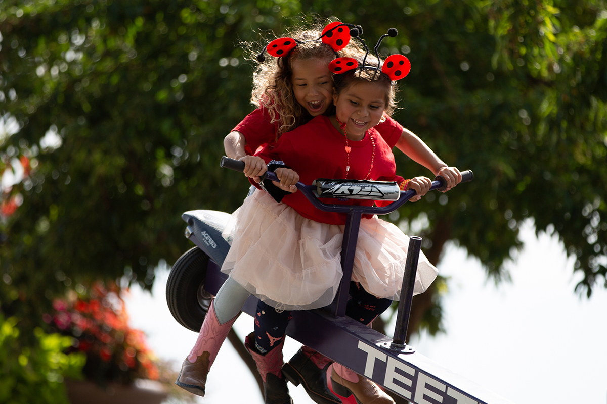 two girls on teeter totter