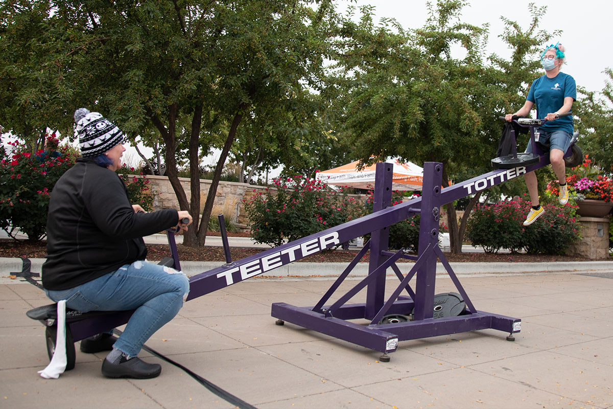 two women on a teeter totter