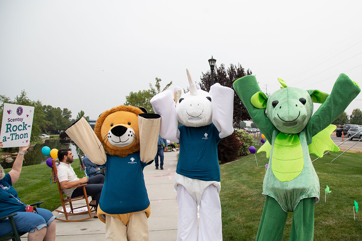 three people dressed up in costume as a lion, unicorn and dragon
