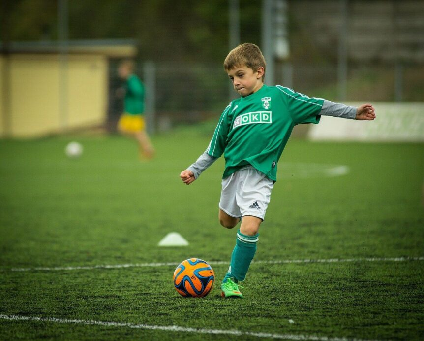 child playing soccer to show child eye problems can occur in sports