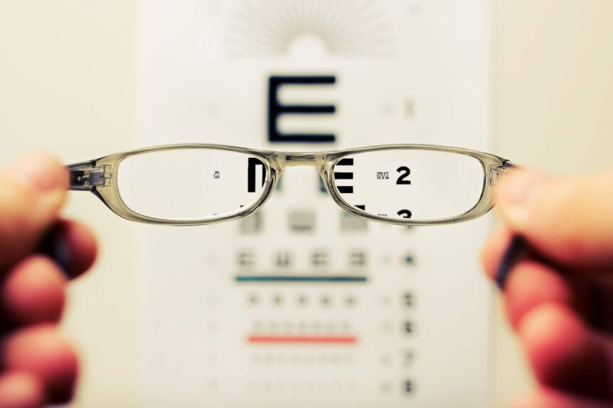 pediatric ophthalmologist holding up glasses for vision test