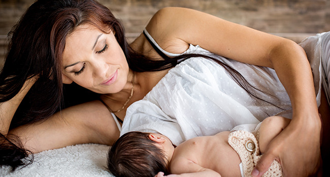 beautiful mother feeding her newborn with breast