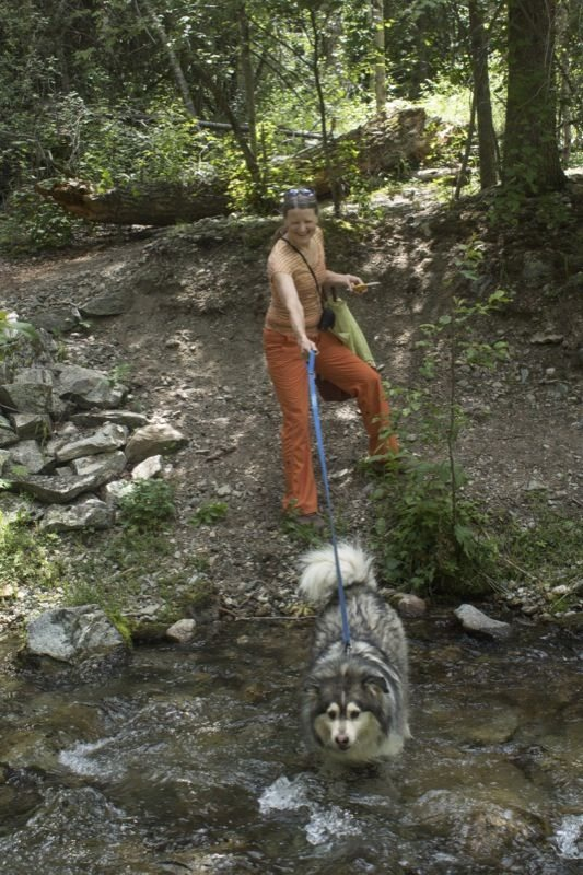 Yuki drags Mary Miller down to Columbine Creek.