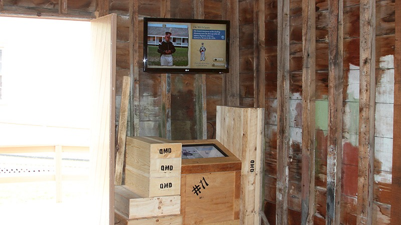 """Mackinac State Historic Parks hired Future Media Corporation to design and program an interactive touch screen display """"The Quartermaster Storehouse"""" that allows visitors to navigate through images of uniforms and chandlery used by soldiers at Fort Mackinac in the 1800s."""