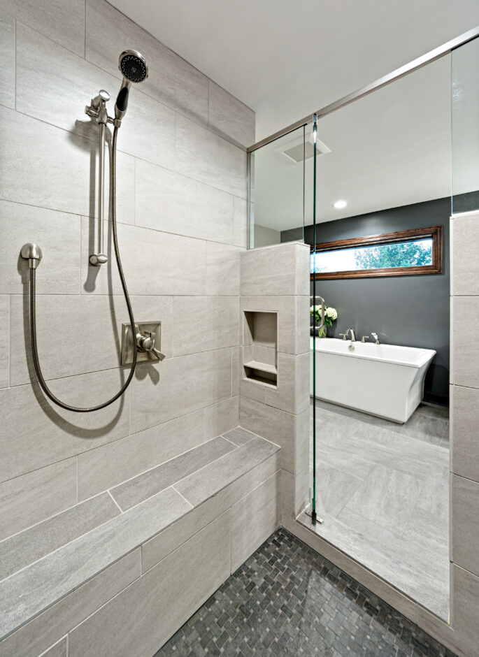 Master shower with view of tub