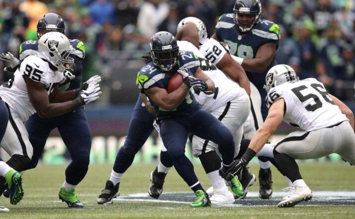 Lynch correu para dois touchdowns
