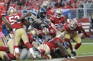 Lynch pula a defesa para o touchdown