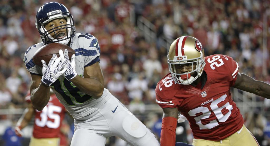 Tyler Lockett recebe seu primeiro passe para touchdown na carreira