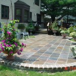 Multi-Color Slate Patio with a Paver Wall
