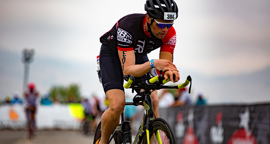 man cycling in a race