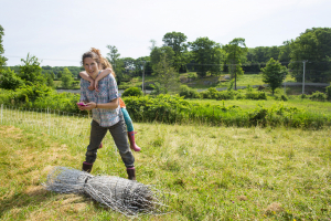Farmer Whitney and Penny rolling up fencing