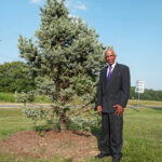 Michael Lewis, Sr. with the 500 lb Colorado Spruce he planted!