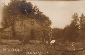 Postcard of old cabin