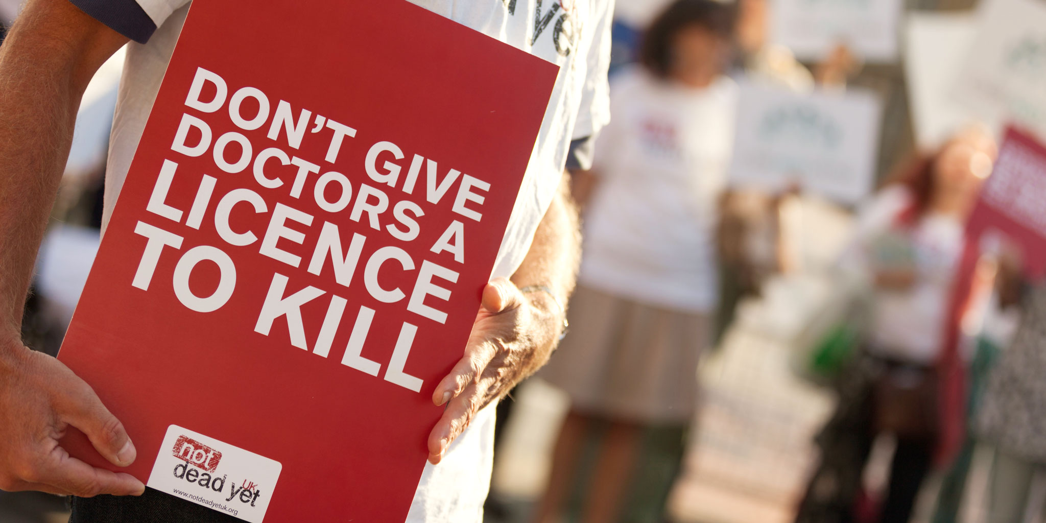 Sign reading Don't Give Doctors A Licence To Kill