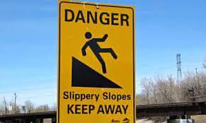Sign saying Danger Slippery slopes keep away.
