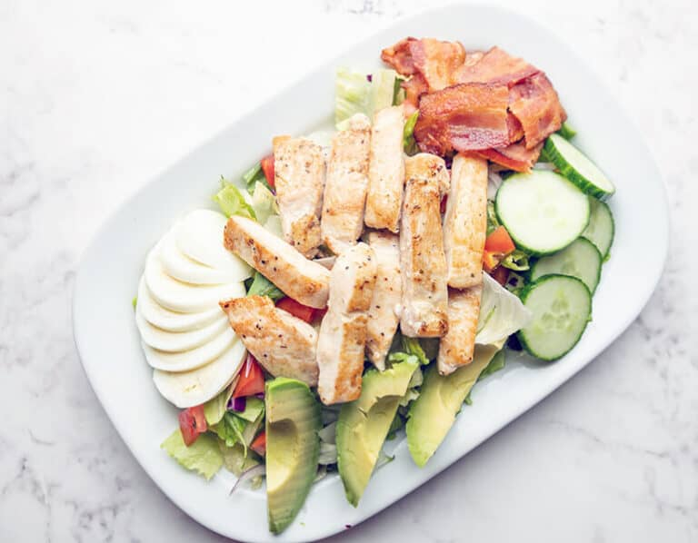 Chicken salad with avocado, bacon and egg