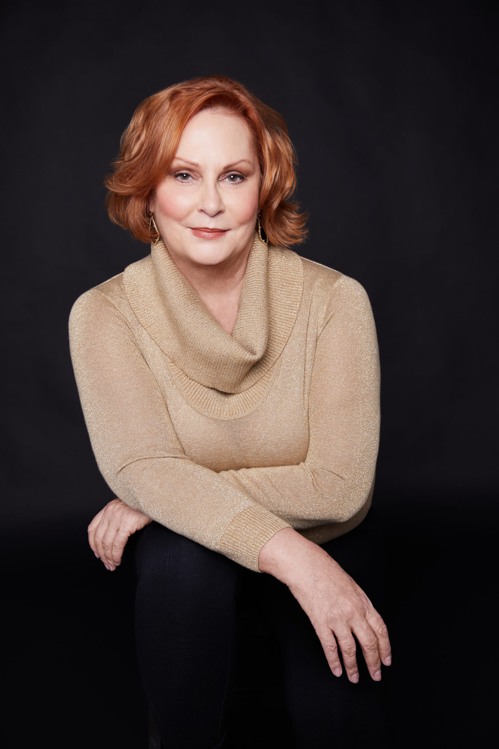 Houston's best headshot photographer Angi Lewis Photography headshot of woman in gold sweater with red hair