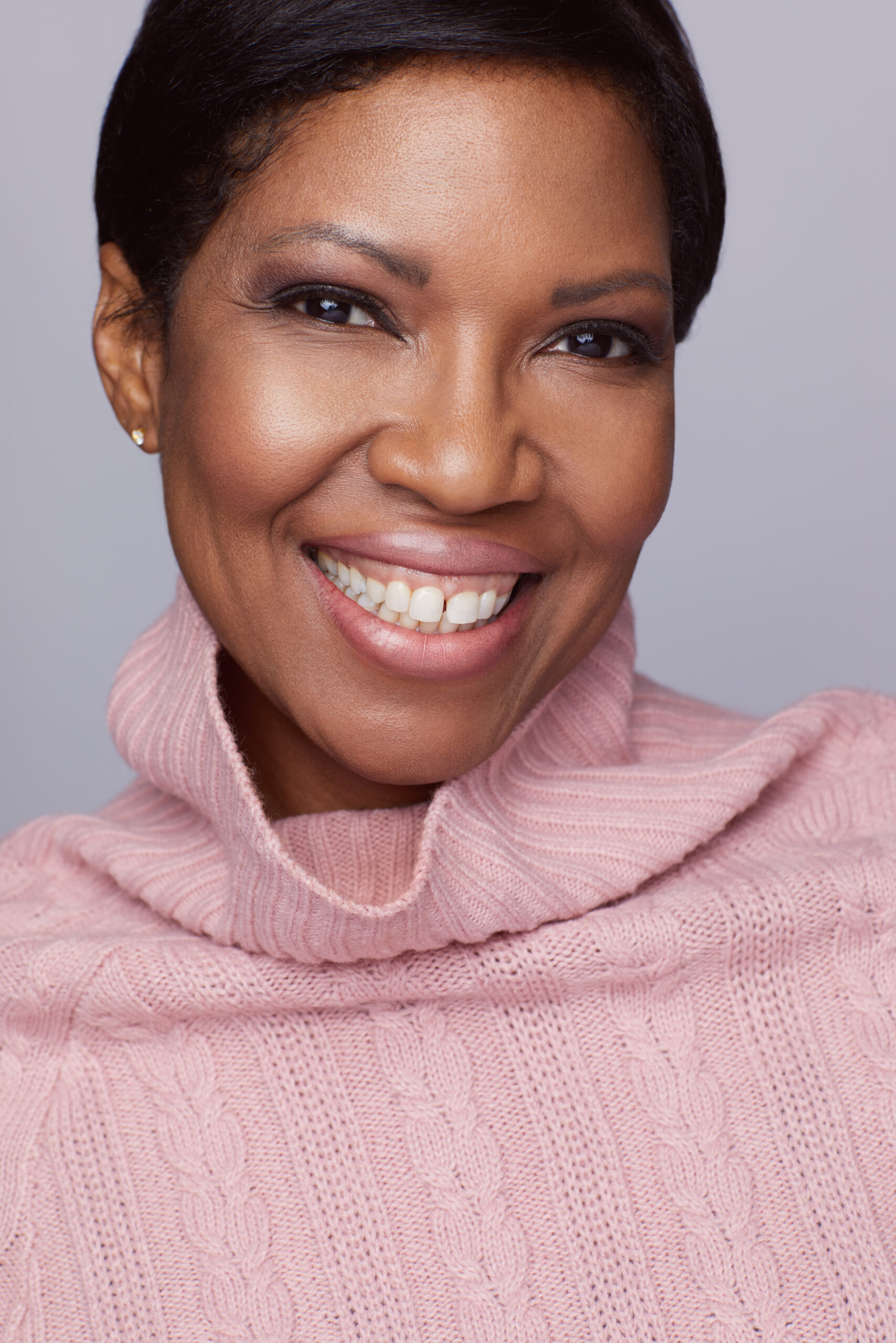 Houston's best headshot photographer Angi Lewis Photography headshot of african american woman in pink turtleneck sweater