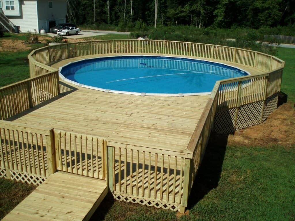 high capacity above ground pool with deck and ladder