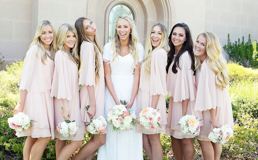 Bride and Bridesmaids holding bouquets in front of Newport Beach Temple. LDS Bride. Wedding Flowers.