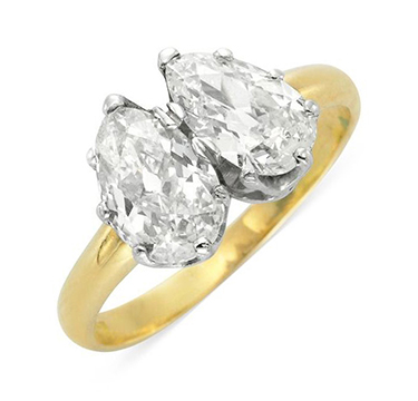 An Antique Twin-stone Pear-shape Diamond Ring, weighing 0.76 and 1.26 carats, late 19th century