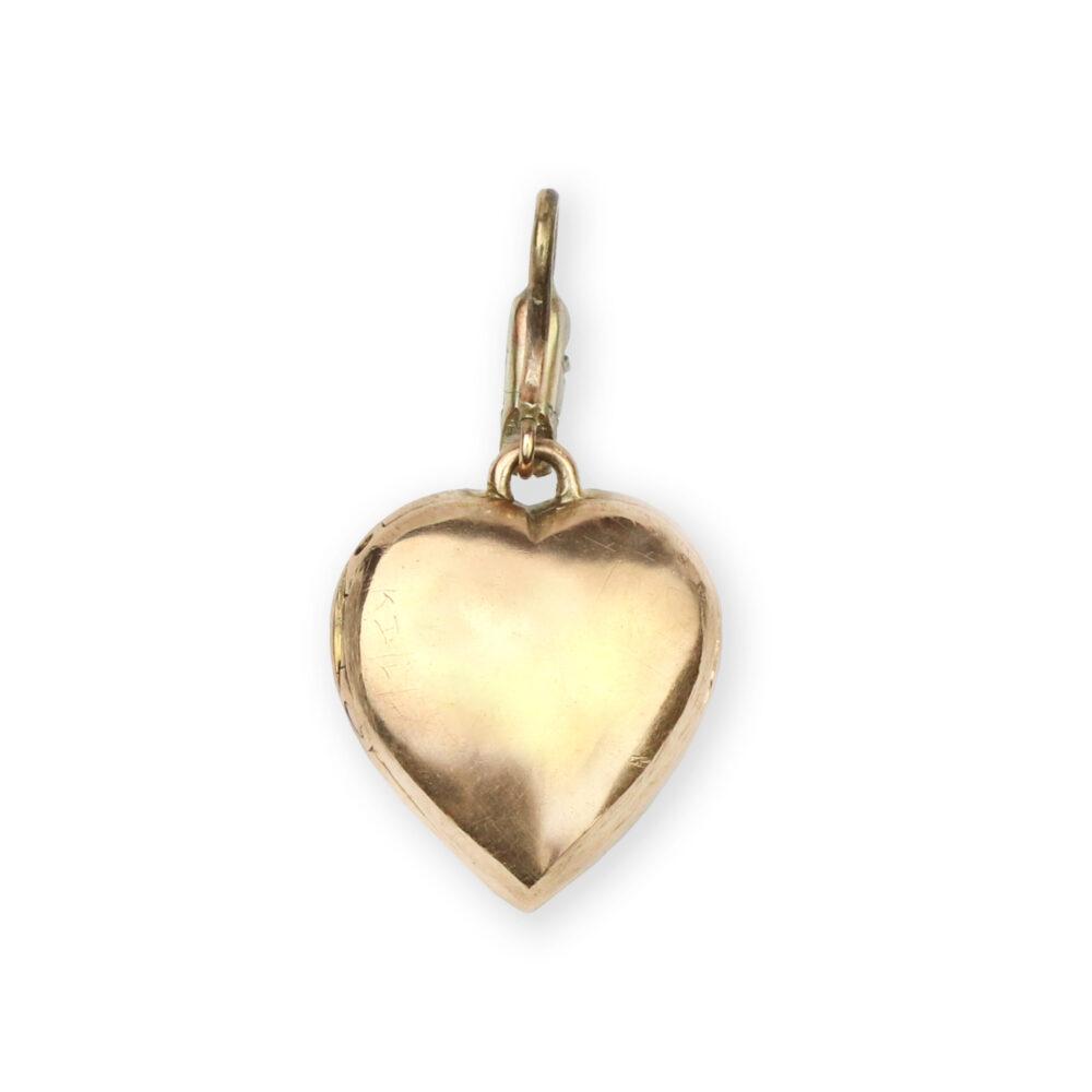 An Antique Diamond Set Heart Locket Pendant