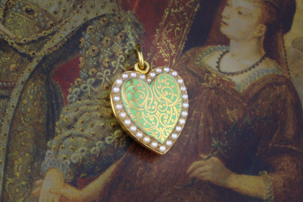 An Antique Seed Pearl, Enamel And Gold Locket Pendant