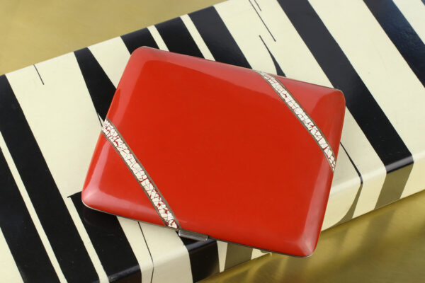 An Art Deco Silver And Red Lacquer Case